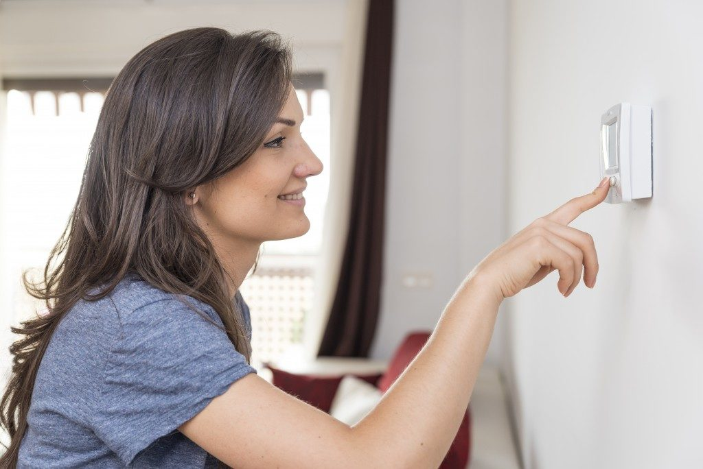 Woman pressing on the button to adjust temperature