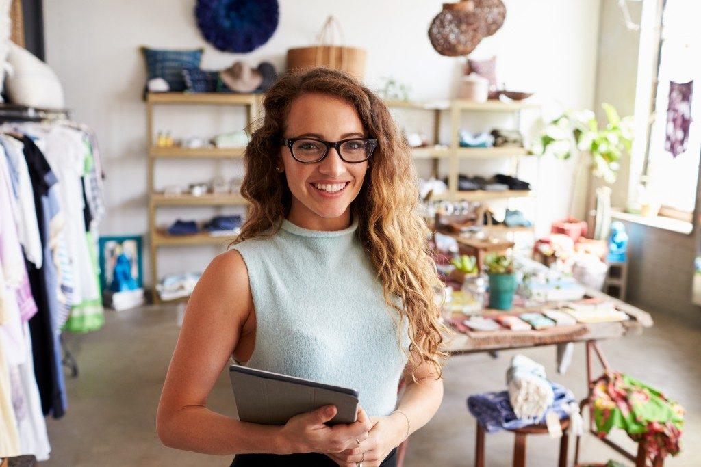 woman entrepreneur standing inside her store