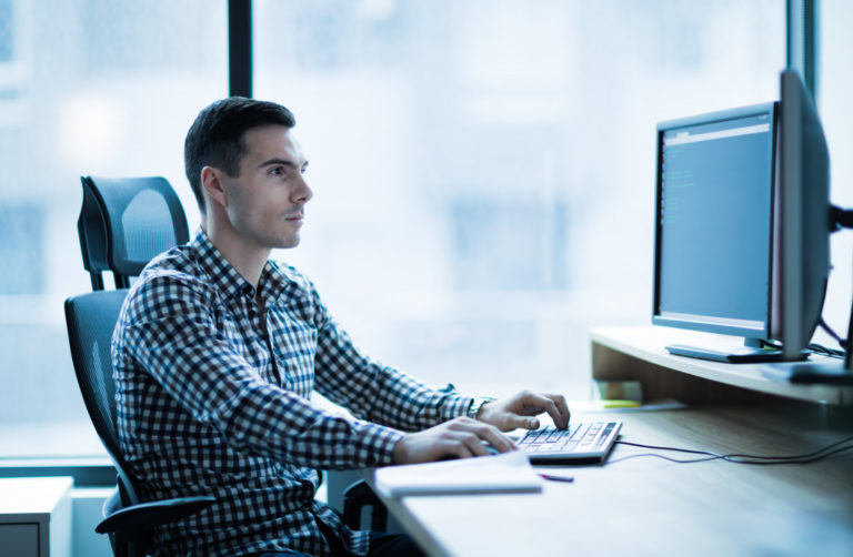 man using office desktop