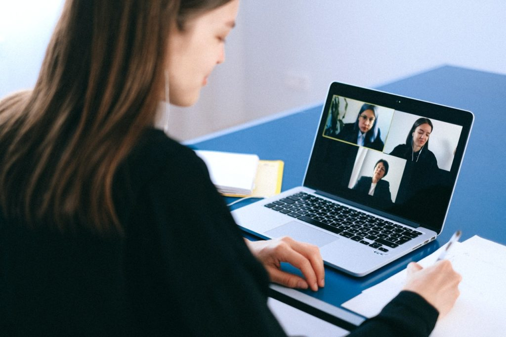 woman working remotely attending video meeting