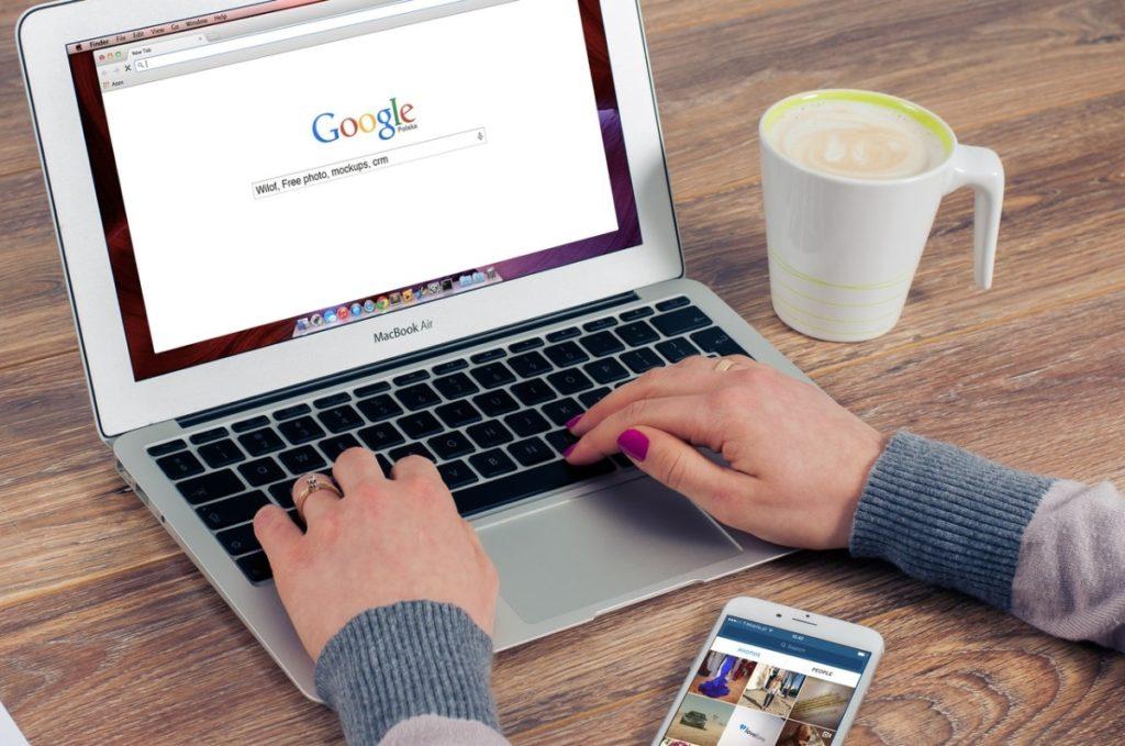 man doing a google search