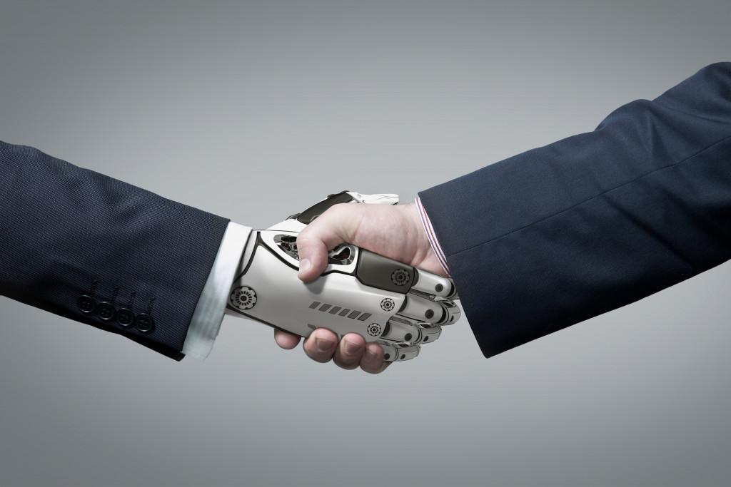 Business Human and Robot hands in handshake