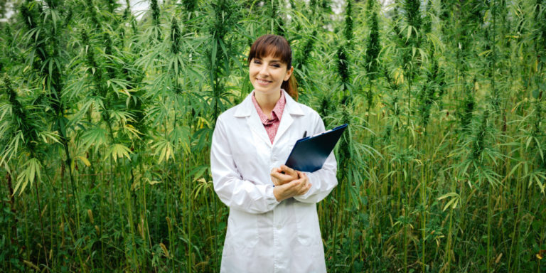 Scientist in front of plants